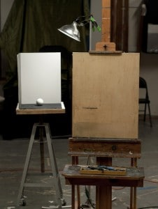 Sphere, light and shadow box configuration at the studio, with easel and drawing board.