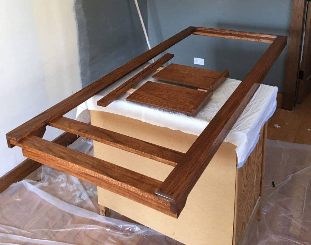 My easel frame and a few other components sit drying after a third coat of polyurethane.