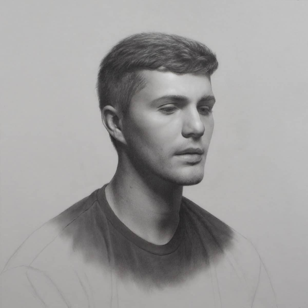 "Portrait drawing of Ethan. Graphite, carbon black and white chalk on gray paper 18"" x 18"""